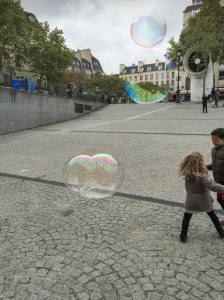 Chasing bubbles in front of Centre Pompidou